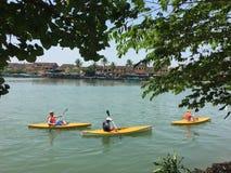 Tourists rowing kayak in Hoian, Vietnam Royalty Free Stock Photo