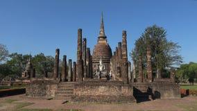 Tourists on the ruins of a Buddhist temple Wat Sa Si. Sukhothai, Thailand. Sukhothai, Thailand - December 25, 2018: Tourists on the ruins of a Buddhist temple stock footage