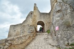 Tourists on ruins castle. stock photo