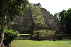 Tourists in ruins of Mayan temple at Yaxha, Guatemala Stock Image