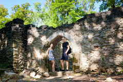 Tourists in Ruins of Sostyn castle. Beautiful young couple in old ruins of Sostyn castle, near Koprivnice. Beautiful Czech landscape Royalty Free Stock Photo