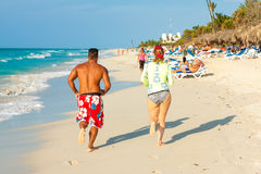 Tourists running at the beach of Varadero in Cuba Stock Photography