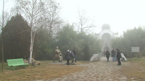 Tourists in the Rupite, Bulgaria, winter, fog. Temple of Saint Petka built Vanga, Bulgarias tourist attractions, a place of pilgrimage for fans in Rupite stock footage