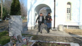 Tourists in Rupite of Vanga, Bulgaria. Temple of Saint Petka built Vanga, Bulgarias tourist attractions, a place of pilgrimage for fans in Rupite stock footage