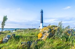 Tourists at the Sõrve Lighthouse by the Baltic Sea. Photo taken in summer at Saaremaa Island, Estonia royalty free stock photo