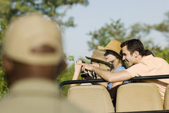 Tourists On Safari Pointing At View Stock Photography
