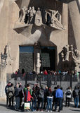 Tourists at Sagrada familia cathedral main entry Royalty Free Stock Photos