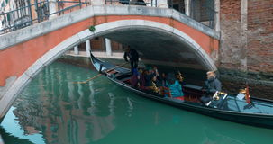 Tourists Sailing in Gondola along the Water Canal stock video