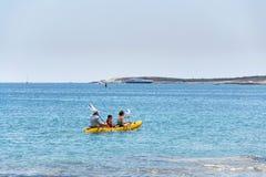 Tourists sailing on kayak on Kamenjak peninsula in Premantura, Croatia royalty free stock photography