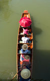 Tourists sailing on thai long tail boat Thailand. Tourists sailing on traditional thai long tail boat at Amphawa floating market Thailand royalty free stock photography