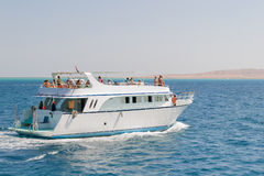 Tourists sailing on a yacht in the Red sea. Hurgada, Egypt. Royalty Free Stock Photos