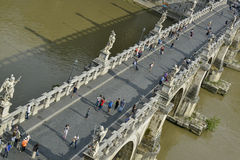 Tourists on the saint angelo bridge in rome Royalty Free Stock Photography