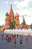 Tourists by Saint Basils cathedral in Moscow Royalty Free Stock Photography