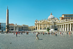 Tourists at Saint Peters Square in Vatican of Italy Stock Image