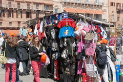 Tourists at sales kiosk in Siena, Italy. Stock Images
