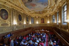 Tourists in the Salle Louis Liard of Sorbonne university, Paris, France. Paris, France - September 14, 2013: People in the Salle Louis Liard of Sorbonne Royalty Free Stock Image