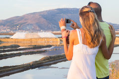 Tourists at salt marsh Stock Image