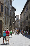 Tourists in San Gimignano, Tuscany, Italy. Stock Images