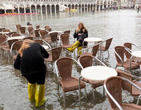 Tourists in San Marco square with high tide, Venice, Italy. Stock Photography