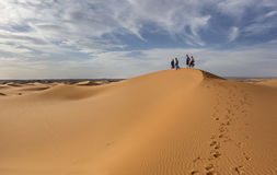Tourists on sand dunes Royalty Free Stock Image
