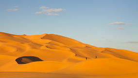 Tourists in the Sand Dunes of the Sahara Desert Stock Photo