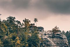 Tourists on a scenic view point in Bastei natural park, Germany royalty free stock image