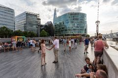 Tourists at the Scoop on the South Bank, London. With the Shard in the background royalty free stock photos