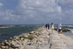 Tourists on seawall at South Inlet Park Boca Raton Florida Royalty Free Stock Photo
