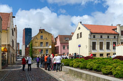 Tourists see sights in street of Old Town in Klaipeda Stock Image