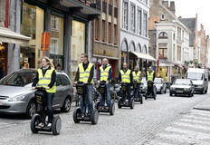 Tourists on Segways in Brugge Stock Image