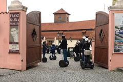 Tourists on Segways in the Museum of Kafka. Royalty Free Stock Photography