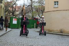 Tourists on Segways on the streets of Prague Royalty Free Stock Photography