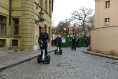 Tourists on Segways on the streets of Prague. Royalty Free Stock Photos