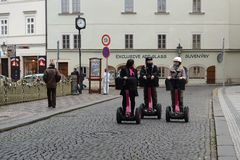 Tourists on Segways on the streets of Prague. Stock Photo