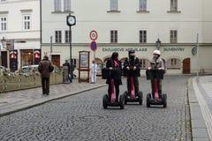 Tourists on Segways on the streets of Prague. Stock Photo