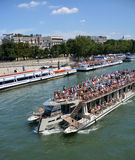 Tourists on a Seine River Boat Tour of Paris, France. Stock Images