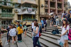 Tourists with selfie stick of Macau steps stock photo