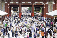 Tourists in the Senso-ji Temple in Tokyo, Japan. The Senso-ji Buddhist temple is the symbol of Asakusa and one of the most famous temples in all of Japan Royalty Free Stock Photography