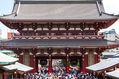 Tourists in the Senso-ji Temple in Tokyo, Japan. The Senso-ji Buddhist temple is the symbol of Asakusa and one of the most famous temples in all of Japan Royalty Free Stock Images