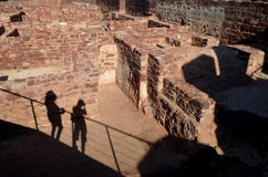 Tourists shadows between de ruins of Castle of Silves, Portugal Royalty Free Stock Image