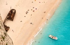 Tourists on a shipwreck beach Royalty Free Stock Images