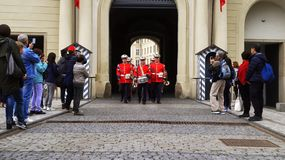 Tourists shoot the guard of honor ceremony at Prague Castle. 2019 royalty free stock image