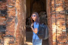 Tourists are shooting portrait. Selfie portrait. Travel and tourism. Young Asian woman walk at temple in old city of Ayutthaya in royalty free stock images