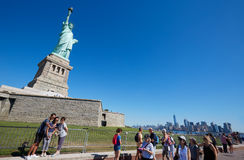 Tourists shooting selfies and walking near Statue of Liberty, New York Royalty Free Stock Photo