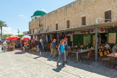 Tourists and shoppers walking by Acre's turkish bazaar Royalty Free Stock Photo