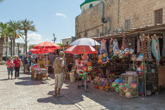 Tourists and shoppers walking by Acre's turkish bazaar Royalty Free Stock Image
