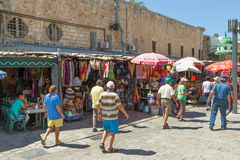 Tourists and shoppers walking by Acre's turkish bazaar Stock Photos