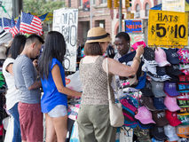 Tourists shopping for souvenirs in New York City Royalty Free Stock Photo