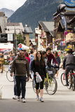 Tourists shopping on the streets of duty-free area on 1 August 2016 in Livigno, Italy. Stock Photos