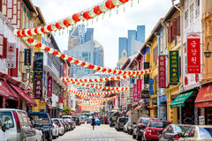 Tourists shopping at traditional China Town market place. SINGAPORE - February 19: Tourists shopping at traditional China Town market place on Feb 19, 2014 at stock image
